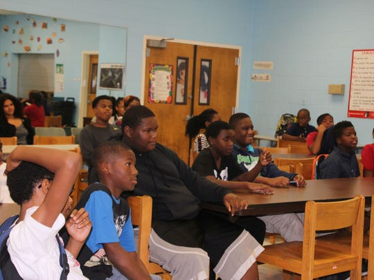The students at Gifford Youth Achievement Center had tons of questions for former Atlanta Falcons player Zeke Motta.