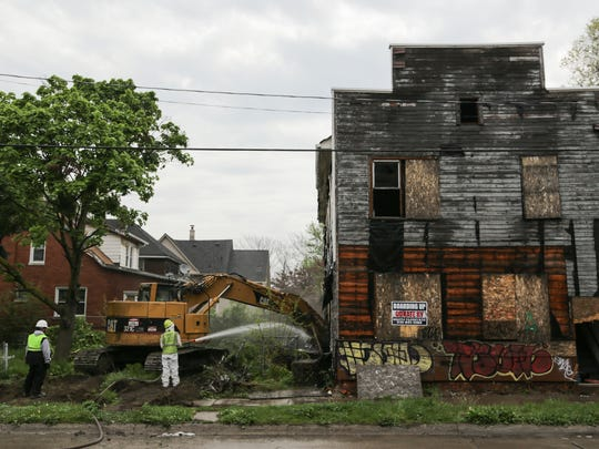 City of Detroit Construction Services workers tear