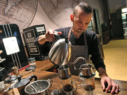 Chis Kilander makes clasic Vietnamese coffee that he will lighten with sweetened condensed milk at Kaffeine Coffee Co. He co-owns the coffee business with his wife Amanda Kilander.
