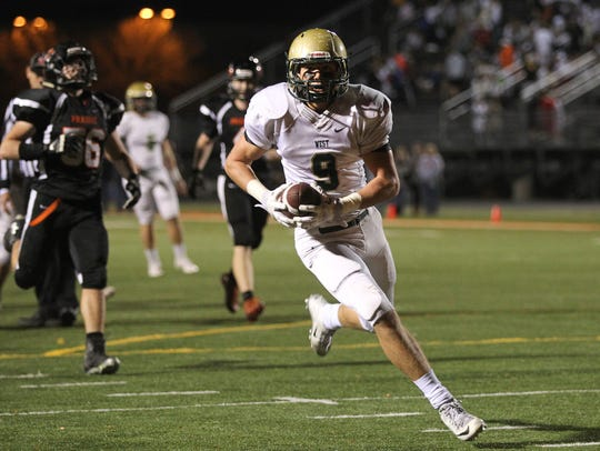 West High's Dillon Doyle runs in for a touchdown in