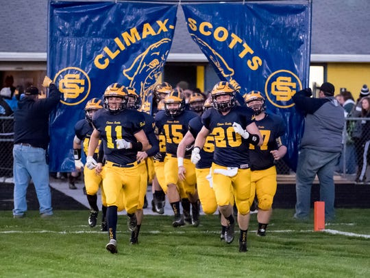 Climax-Scotts takes the field before the game playoff game against Mendon Friday evening.