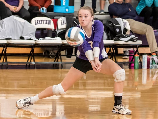 Lakeview's emma Morey (7) gets the dig ball during district volleyball finals at Lakeview on Saturday.