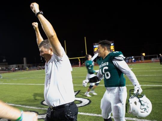 King's head coach Eddie Hesseltine celebrates after defeating Ray 35-34 at Buccaneer Stadium on Friday, Nov. 4, 2016.