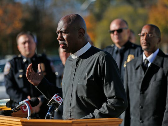 Rev. Charles Harrison speaks during a press conference at Mount Zion Baptist Church, Sunday, November 6, 2016.  After the press conference, members of IMPD, clergy, and the Indianapolis Ten Point Coalition went for a walk around the neighborhood celebrating one year without a criminal homicide in the Crown Hill Neighborhood.