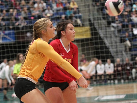Carroll Kuemper's Aimee Adams, left, and Taylor Promes