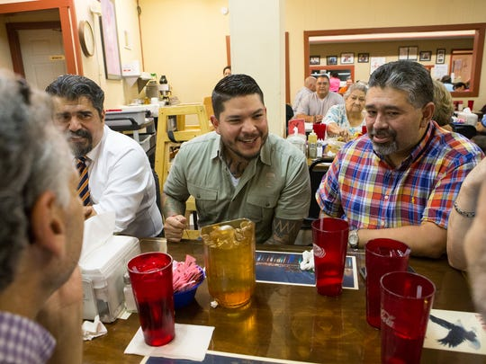 Mark Gonzalez (center) jokes with friends and colleagues as they eat at the Hi-Ho Restaurant Wednesday morning after he won the Nueces County district attorney race.