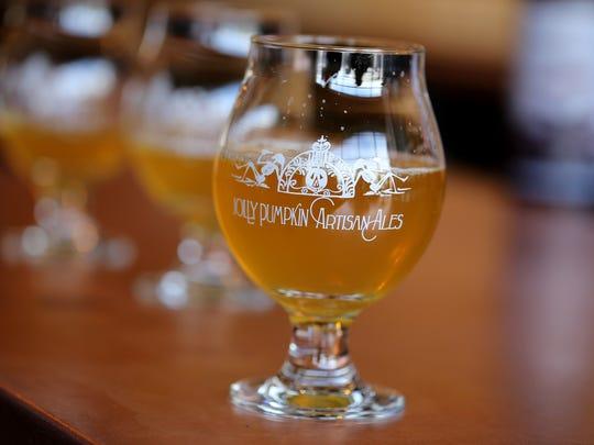 A Jolly Pumpkin goblet contains Saison Ale at Jolly Pumpkin Artisan Ales, Pizzeria and Brew Pub on Thursday, March 5, 2015.