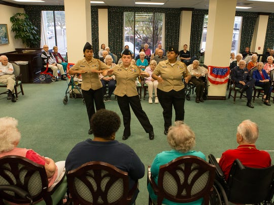 Moody High School Navy Junior ROTC students conduct a drill during a ceremony to honor veterans at Trinity Towers retirement community, Thursday, Nov. 10, 2016.