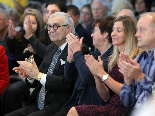John Pappajohn applauds Mary Joy and Jerre Stead during