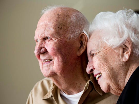 Leon Hesser, a retired Army Staff Sergeant who served in World War II, smiles with his wife Florence, a lifelong educator who tutored former President Carter's daughter, Amy, sit for a portrait at American House Bonita Springs Senior Living Tuesday, Nov. 8, 2016 in Bonita Springs.