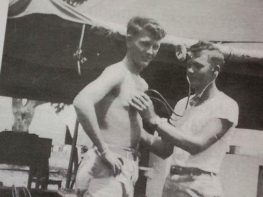 Leon Hesser, right, listening to a heartbeat. Taken from Leon's memoir Zig Zag Pass: Love and War, A Memoir.
