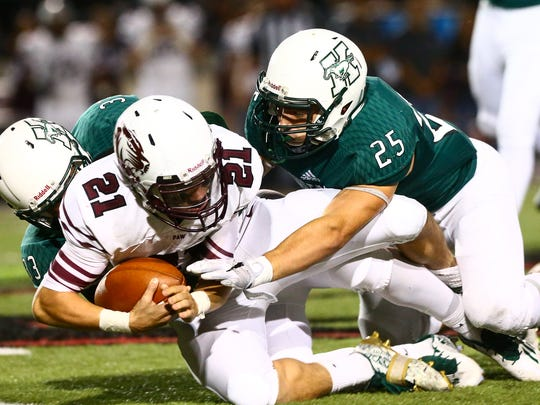 King's Nicholaas Garcia and Bryson Butler tackle Floresville's Kane Numera as he runs a kick retrun during first quater of the Class 5A Division II bi-district playoff game at Buccaneer Stadium on Friday, Nov. 11, 2016.