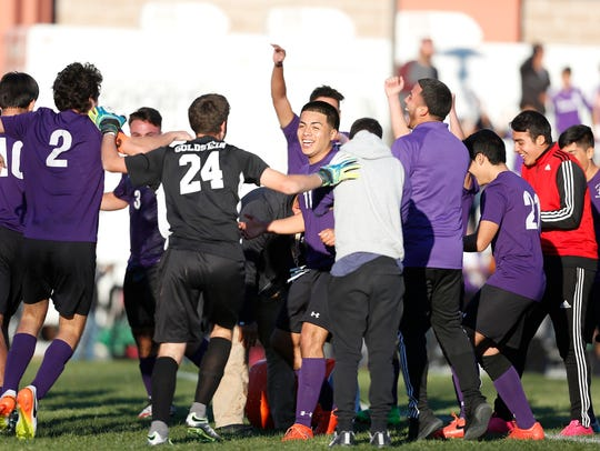 New Rochelle celebrates their 2-1 win over Fairport