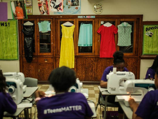 Clothing hangs inside fashion design classroom as part of After School Matters at Chicago Vocational Career Academy  in Chicago.