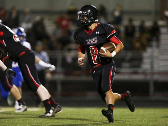 North Salem running back Alex Vasquez (8) looks for a way through the line in a game this season. The North Salem booster club helps provide special projects at the school.