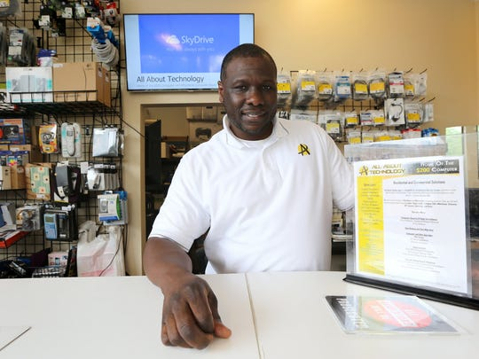 Willie Brake, 41, at his electronics store in Detroit called All About Technology on Thursday, July 9, 2015.