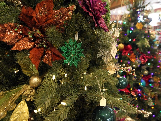 Christmas decorations hang on trees at Pleasant Valley