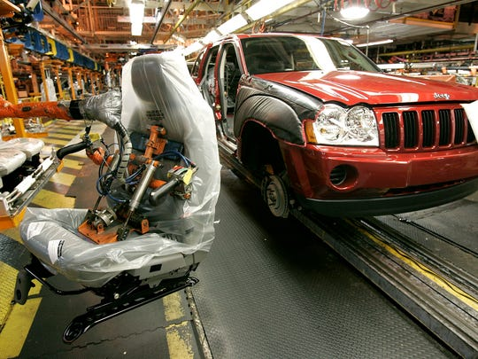 A seat manufactured by Johnson Controls awaits installation into a Jeep Grand Cherokee at the Chrysler Jefferson North assembly plant in Detroit, July 28, 2005.