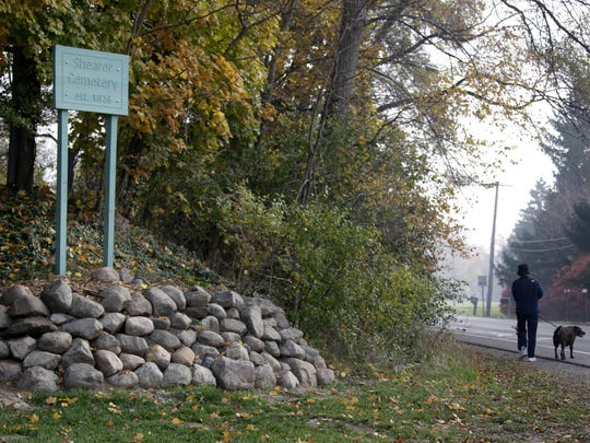 A new large rock wall surrounds the sign for Shearer Cemetery in Plymouth Township, a visible reminder of the donations and support that boosted an effort to restore the old cemetery, where some of the town's pioneers are Ñ or once were Ñ buried.