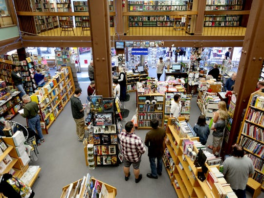 Customers browse the Book Bin in Salem on Saturday,