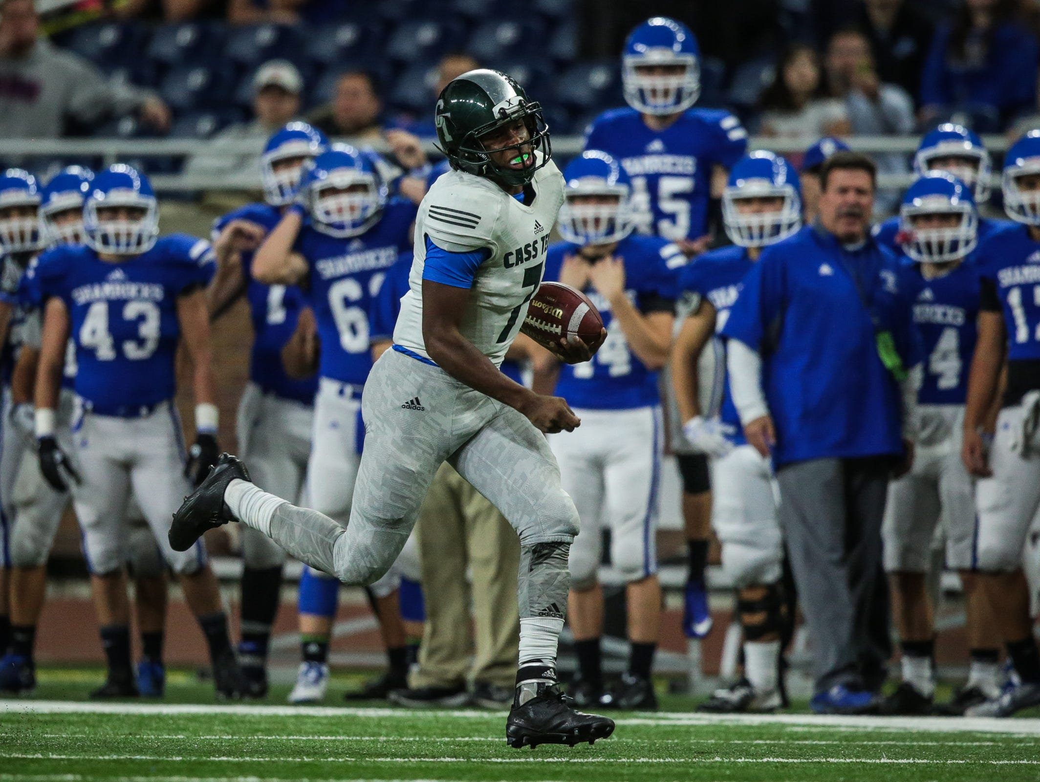 Detroit Cass Tech's Hall Rodney (7) runs the ball against Detroit Catholic Central during the Division 1 High School Championship game on Saturday November 26, 2016, at Ford Field in Detroit, MI.