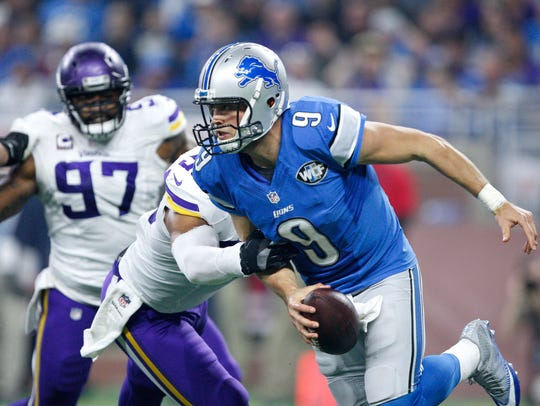 Matthew Stafford looks to evade pressure against the Vikings in a 2016 game.