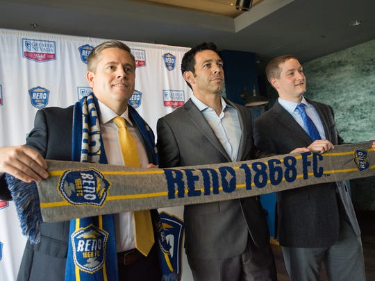 Ian Russell, center, is introduced as the Reno 1868 FC soccer coach on Thursday at Greater Nevada Field.. Andy Smith, team GM is left, and Reno Aces president Eric Edelstein is right.