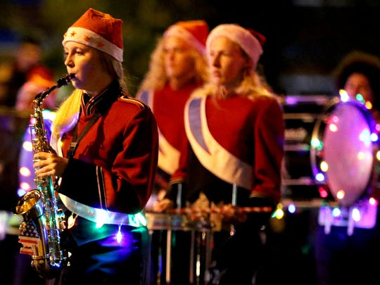 The South Salem High School marching band performs during last year's final Festival of Lights Holiday Parade. The Keizer Holiday Lights Parade will feature McNary, Sprague and South marching bands plus an adult marching band.