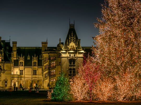 This Nov. 4, 2016 photo shows a massive Christmas tree covered in lights outside The Biltmore House in Asheville, North Carolina. Christmas at The Biltmore continues a holiday tradition that started in 1895 when George Vanderbilt opened the 250-room mansion to family and friends. Attractions this year include more than 70 decorated trees, hundreds of poinsettias and garlands, a 34-foot-tall fir tree in the banquet hall and a 55-foot Norway spruce on the front lawn.