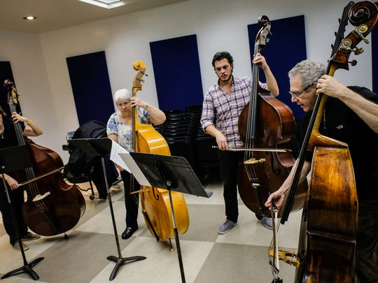 (left to right) Nancy Leipold, of Waterford, MI, Milly Matis, of Eastpointe, MI, and Nick Jakovski, of Ferndale, MI, practice bass with Stephen Molina, DSO assistant principal bass mentor, during the Detroit Community Orchestra rehearsal on Tuesday November 29, 2016, at the Max M. Fisher Music Center in Detroit, MI. Detroit Symphony Orchestra started a community orchestra few months ago, an amateur ensemble comprised of adults who used to play an instrument and have them practice side-by-side with DSO musicians.