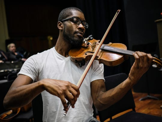 Dileonte Jones, 27, of Detroit, MI, practices his violin during the Detroit Community Orchestra rehearsal on Tuesday November 29, 2016, at the Max M. Fisher Music Center in Detroit, MI. Detroit Symphony Orchestra started a community orchestra few months ago, an amateur ensemble comprised of adults who used to play an instrument and have them practice side-by-side with DSO musicians.