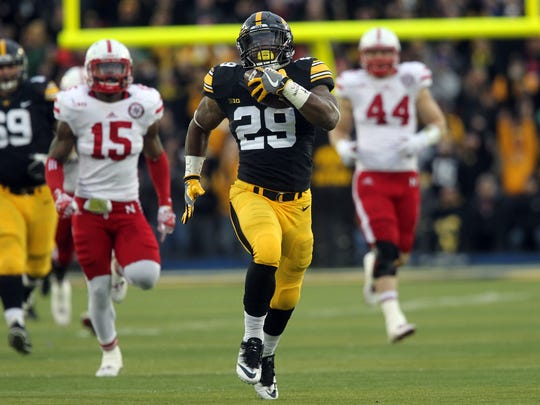 Iowa's LeShun Daniels, Jr. runs down field for a 56-yard