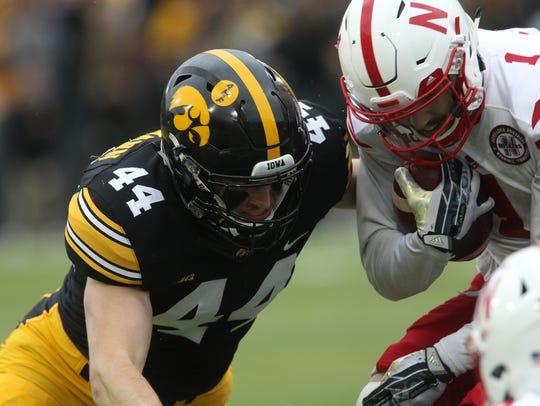 Iowa's Ben Niemann chases down Nebraska's Jordan Westerkamp