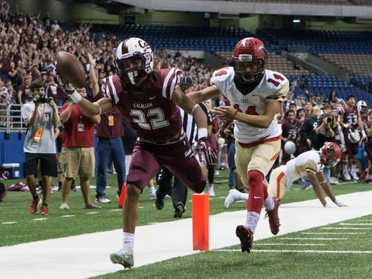 Calallen's Zack Hawkins runs the ball for a touchdown as  Victoria East's Trent Brown gives chase during fourth quarter of the Region IV-5A Division II final at the Alamodome in San Antonio on Friday, Dec. 2, 2016.