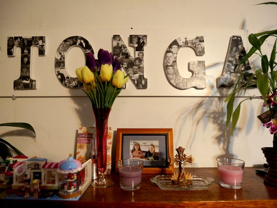 "A family tribute above the fireplace in Rosendo ""Ross"" Tonga's home home in Salem on Monday, Dec. 5, 2016. Tonga immigrated to the United States from Micronesia more than 30 years ago."