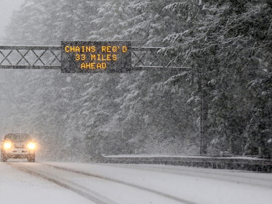 Snow falls near Detroit Lake, Ore., on Monday, on the way to Santiam Pass.
