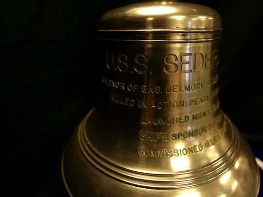 The bell from the USS Sederstrom, a Naval destroyer escort during World War II, is on display at the Oregon Department of Veterans' Affairs in Salem.