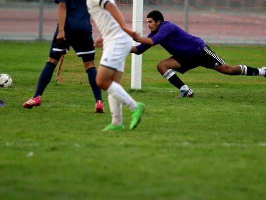 Stayton's Jose Navarro (0) stretches to save the ball in the Stayton vs. North Marion boy's soccer game at North Marion High School in Aurora, Ore., on Tuesday, Oct. 20, 2015. Stayton won the game 3-2.