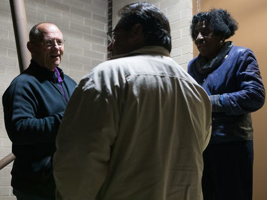Mayor-elect Dan McQueen talks with Daniel Pena and Gloria Scott outside Coles High School during a Citizens Alliance for Fairness and Progress Charter on Monday Dec, 5, 2016.
