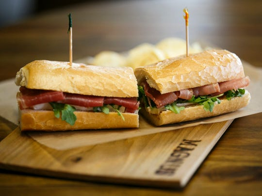 The Prosciutto and Brie sandwich at Magnus Sandwiches is served with fig spread, arugula and butter on french bread.