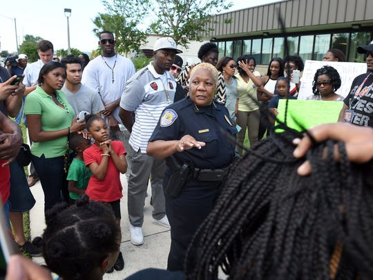 Fort Pierce Police Chief Diane Hobley-Burney addressess a crowd of people gathered in front of the Fort Pierce Police Department on Tuesday, April 26, 2016, in response to the fatal shooting of Demarcus Semer, 21, by a Fort Pierce police officer on April 23 in Fort Pierce.