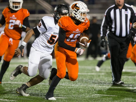 Refugio's Jamel LaFond runs after intercepting a pass during the first quarter of a Class 2A Division I state semifinal game against Centerville at Rattler Stadium in San Marcos on Friday, Dec. 9, 2016.