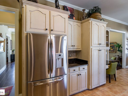 The kitchen at 201 Claremore Circle features a French