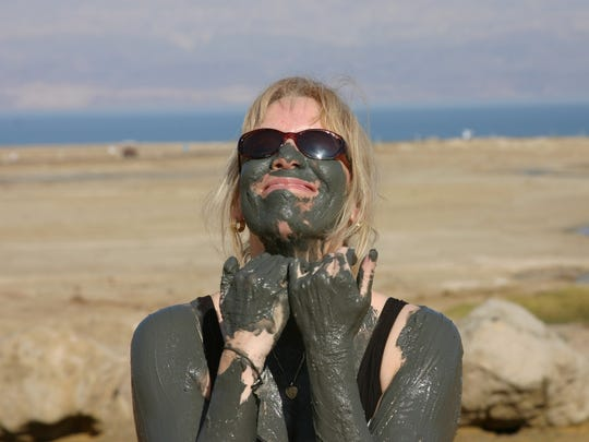 Detroit Free Press reporter Ellen Creager samples the mud at the Dead Sea, Israel in 2007. She was travel writer from 2003 to 2016.