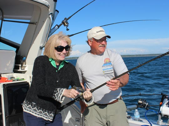 Detroit Free Press reporter Ellen Creager fishing for trout and salmon in Lake Michigan off of Saugatuck for a story in 2015. She was travel writer from 2003 to 2016.