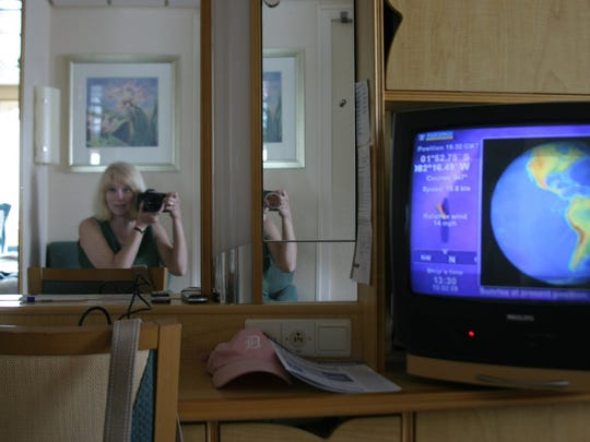 Detroit Free Press reporter Ellen Creager takes a self portrait in her cabin on one of the many cruise ships she traveled as travel writer from 2003 to 2016.