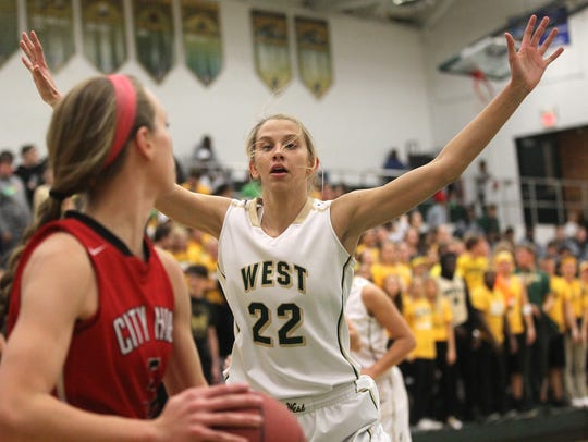 West High's Logan Cook guards City High's Sydney Schroder