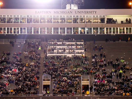 The fans in the stands watch the Eastern Michigan Eagles take on the Central Michigan Chippewas during a game on Tuesday, November 22, 2016 at Rynearson Stadium in Ypsilanti.