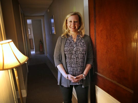 Executive director Wendy Noe stands in the hallway at the former home of Dove Recovery House. The nonprofit just moved into a newly remodeled building on North Meridian Street and will house 38 women in recovery from addiction.