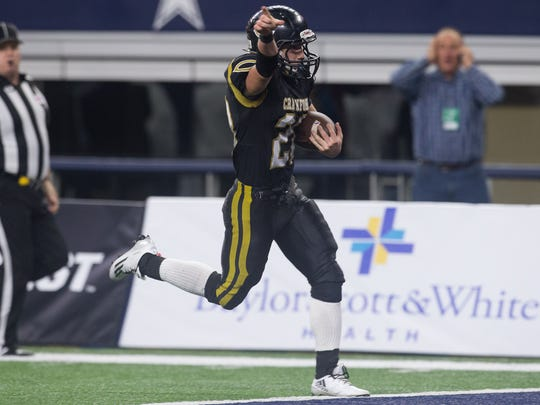 Crawford's Garrett Duschmann runs the ball for a touchdown during the fourth quarter of the Class 2A Division I state championship game against Refugio at AT&T Stadium in Arlington Texas on Thursday, Dec. 15, 2016.